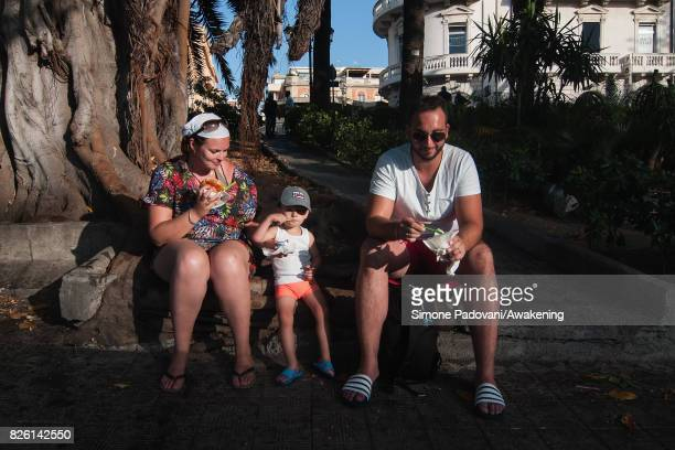 A family eats icecream to cool off from the heat on August 03 2017 in Reggio Calabria Italy An intense heatwave is sweeping across many regions of...