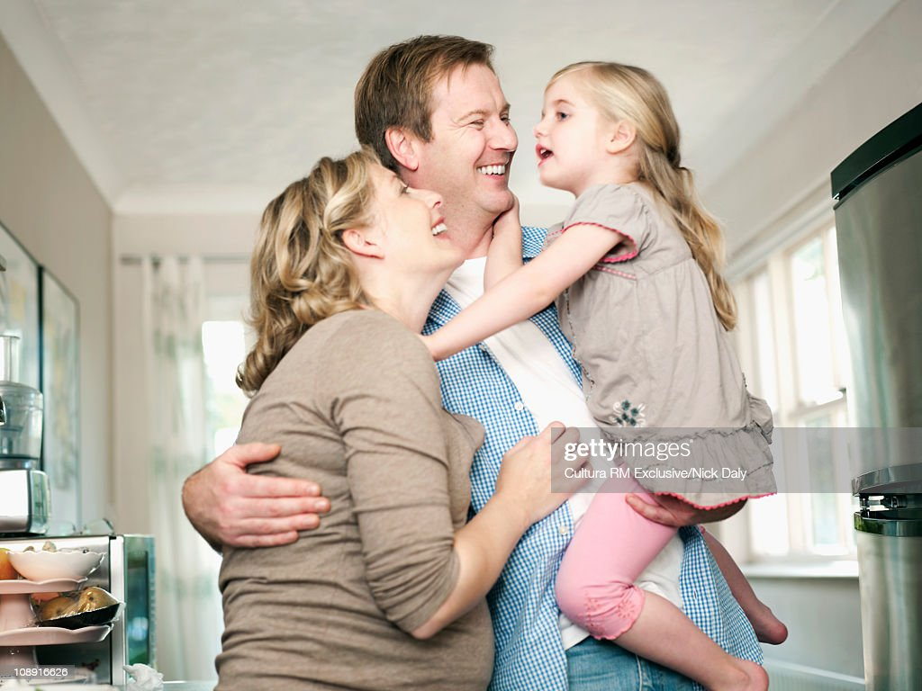 A family embrace in the kitchen : Stock Photo