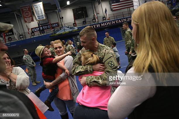 A family embraces at a welcome home ceremony for soldiers returning from Iraq on May 17 2016 at Fort Drum New York More than 1000 US Army soldiers of...