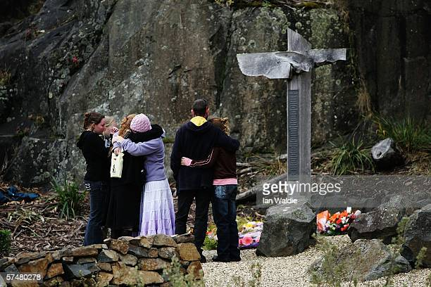 A family embraces at the Port Arthur memorial site during a commemoration service to mark the 10th aniversary of the massacre April 28 2006 in Port...