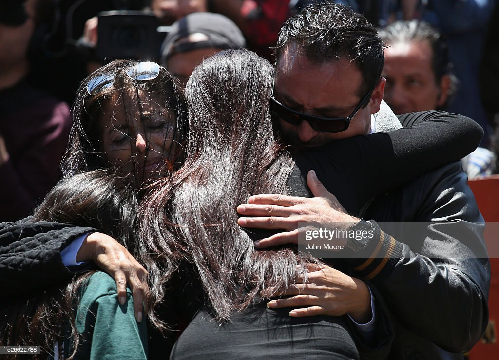 A family embraces at the U.S.-Mexico Border fence during a 'Opening the Door of Hope' event on April 30, 2016 in San Diego, California. Five families, with some members living in Mexico and others in the United States, were permitted to meet and embrace for three minutes each at a door in the fence, which the U.S. Border Patrol opened to celebrate Mexican Children's Day. It was only the third time the fence, which separates San Diego from Tijuana, had been opened for families to briefly reunite. The event was planned by the immigrant advocacy group Border Angels.