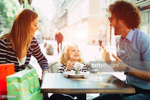 Family Enjoy Outdoors in A Cafe.