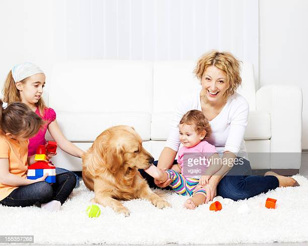 Family enjoy with Retriever at home.