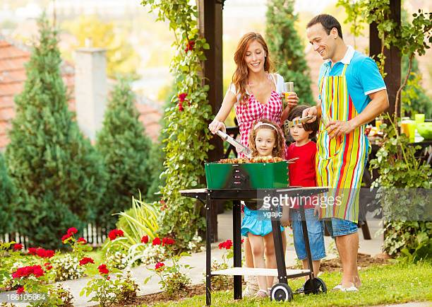 Family Enjoying a barbecue outdoors