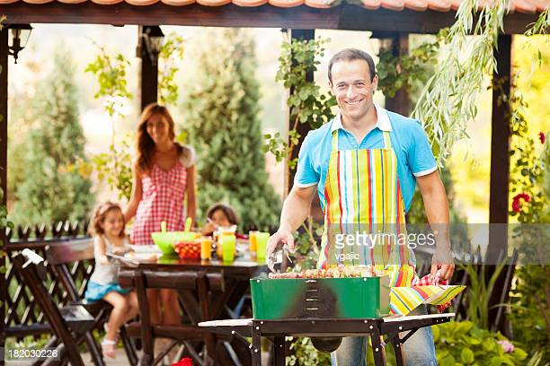Family Enjoying a barbecue