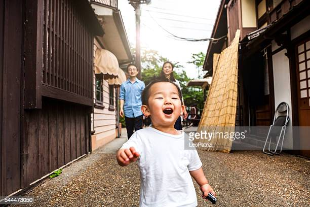 Family enjoying a visit to Kyoto historical old town, Japan