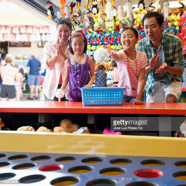 Family enjoying amusement park arcade