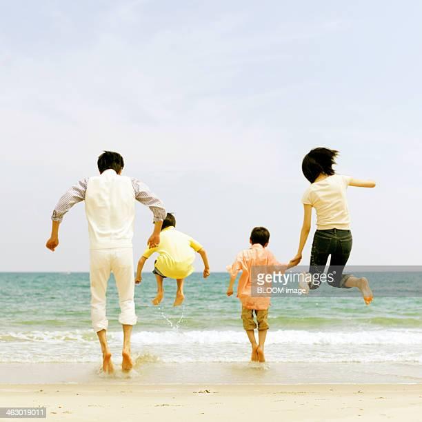 Family Enjoying At Beach