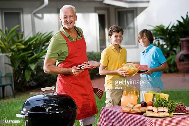 Family enjoying back yard cookout
