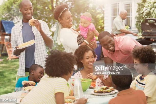 Family enjoying backyard barbecue