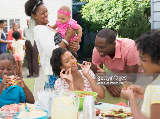 Family enjoying barbecue on patio
