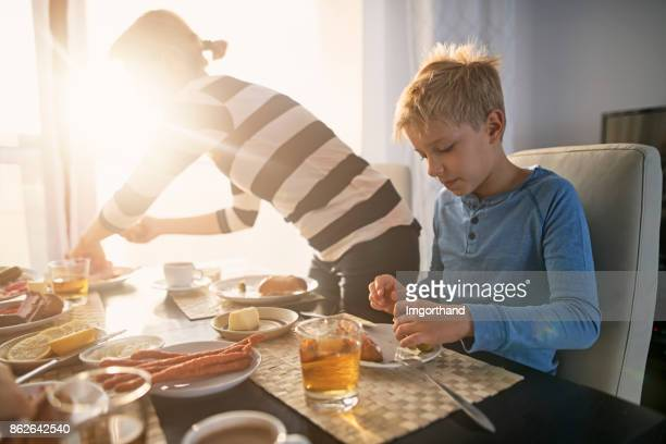 Family enjoying breakfast together on sunny morning