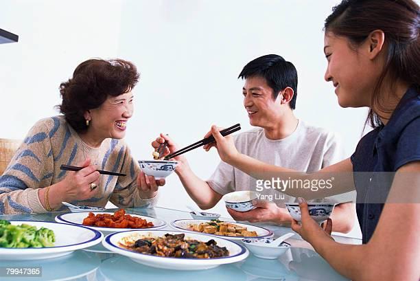 Family Enjoying Chinese Dinner