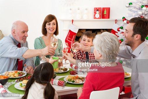 Family enjoying Christmas dinner : Stock Photo