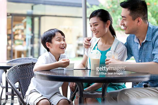 Family enjoying cold drink together