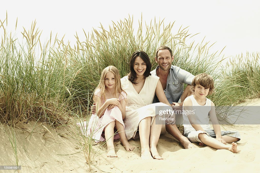 Family enjoying day out at the beach : Stock Photo