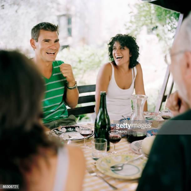 family enjoying dinner in garden