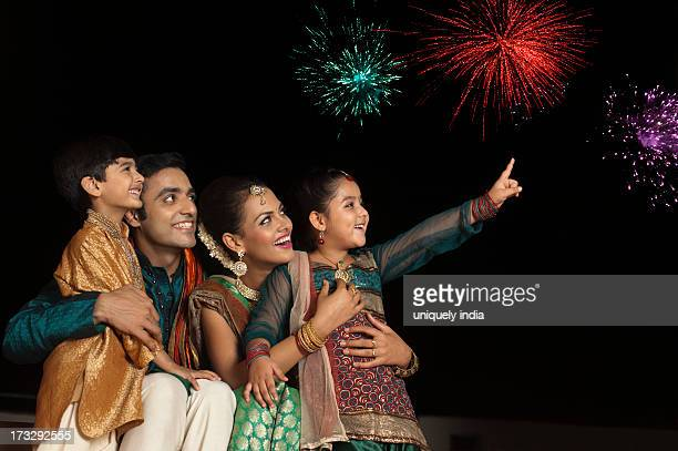 Family enjoying firework display on Diwali