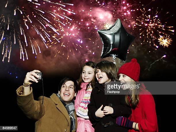 Family enjoying firework display