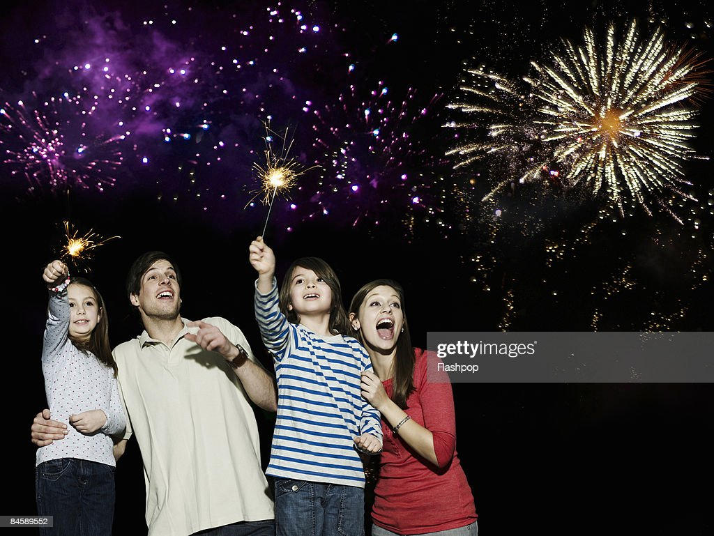 Family enjoying firework display : Stock Photo