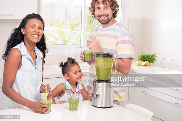 Family enjoying fresh drink.