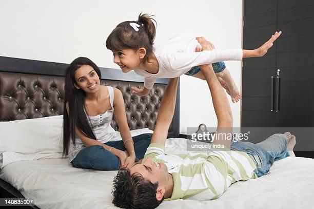 Family enjoying in a bedroom