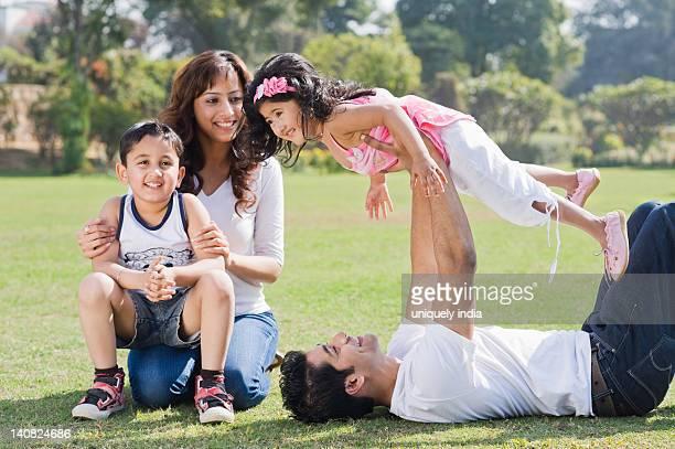 Family enjoying in a lawn, Gurgaon, Haryana, India