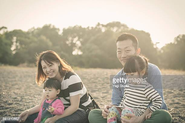 Family enjoying in front of the lake shore