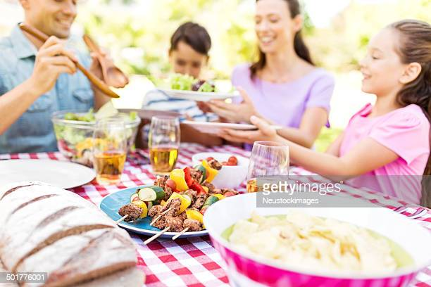 Family Enjoying Meal At Outdoor Table