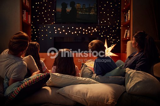 Family Enjoying Movie Night At Home Together : Stock Photo