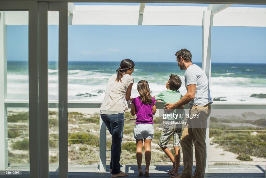 Family enjoying ocean view from patio : Stock Photo