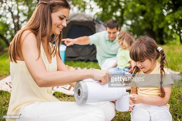 Family enjoying on picnic during springtime.