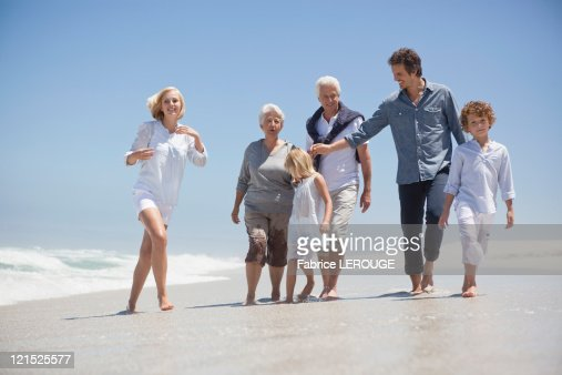 Family enjoying on the beach : Stock Photo