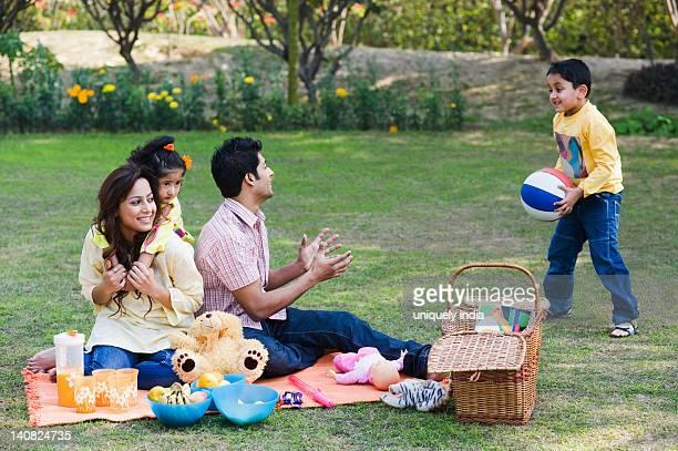 Family enjoying picnic in a garden, Gurgaon, Haryana, India