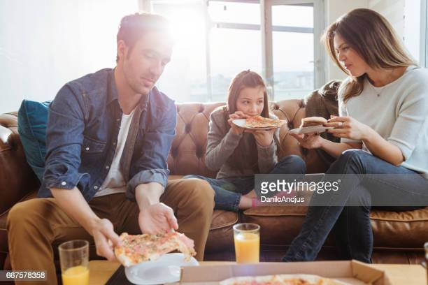 family enjoying pizza for lunch