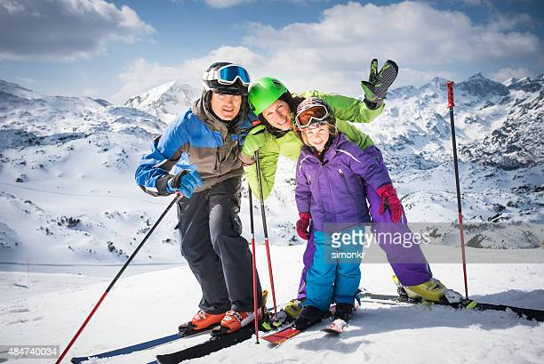 Family enjoying ski holiday, portrait
