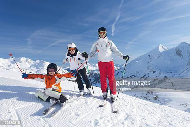 family enjoying skiing vacation