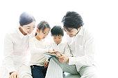 family enjoying tablet computer
