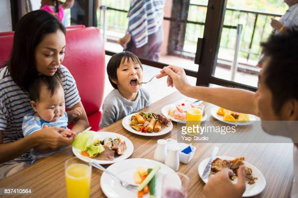 Family enjoying take a buffet style meal at Resort Hotel in guam