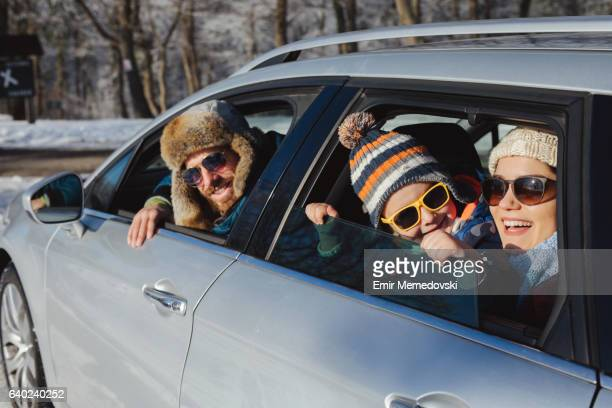 Family enjoying the ride to mountain forest by car