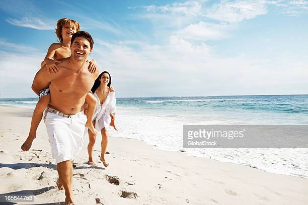 Family enjoying their summer vacation on the beach