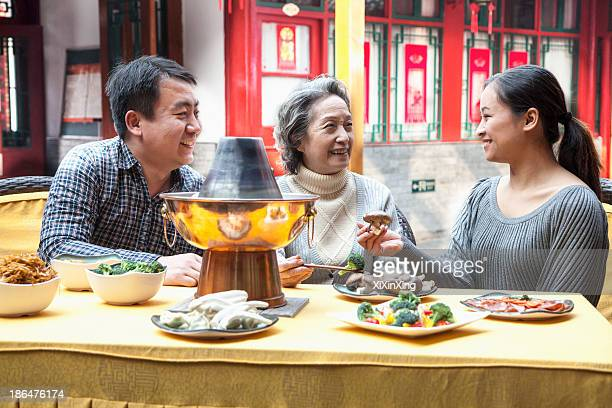Family enjoying traditional Chinese meal