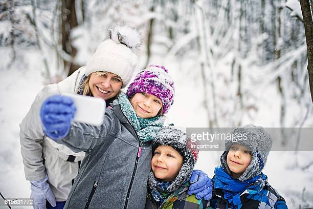 Family enjoying winter walk in forest.