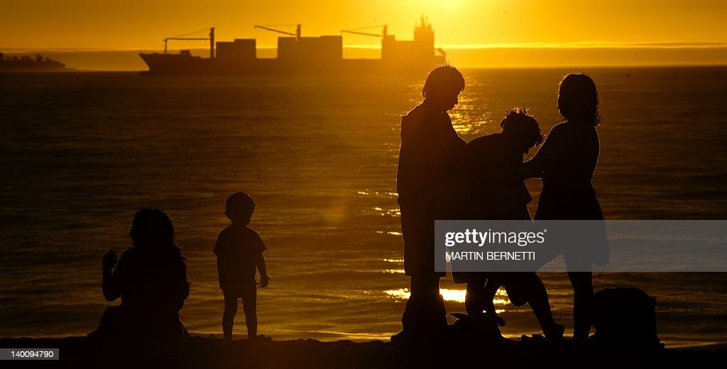 A family enjoys the sunset, on the Bay of Valparaiso in Viña del Mar, Chile, on February 27, 2012.