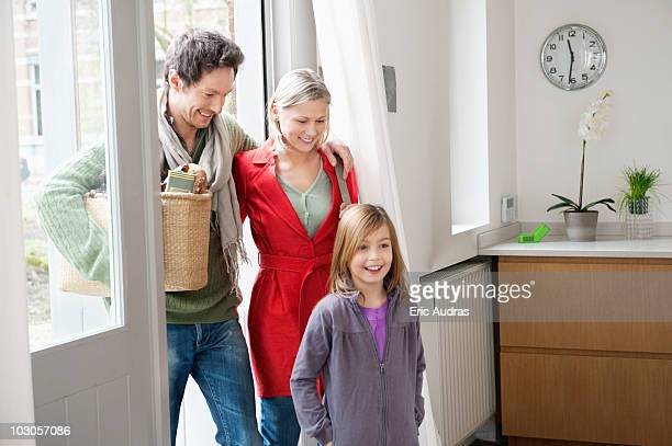 Family entering the house