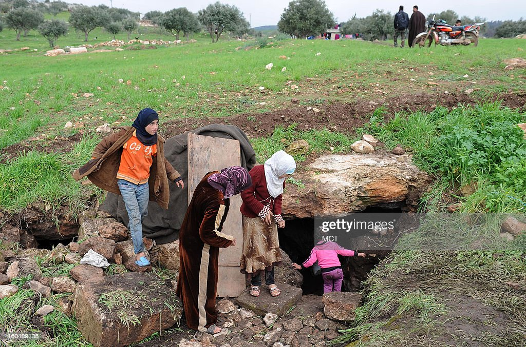 A family enters a cave outside the village of al Sahriah, north of Hama, where this family of 16 is now living. They fled from nearby Kifrimboudah, which is now under air and artillery attack in a government offensive to recapture lost territory.