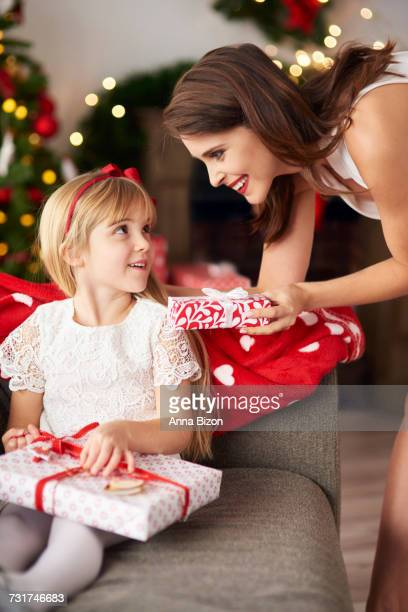 Family exchanging Christmas gifts box. Debica, Poland