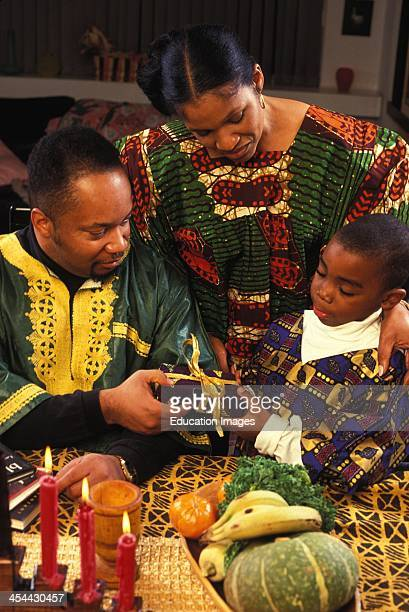 Family Exchanging Gifts At Kwanzaa