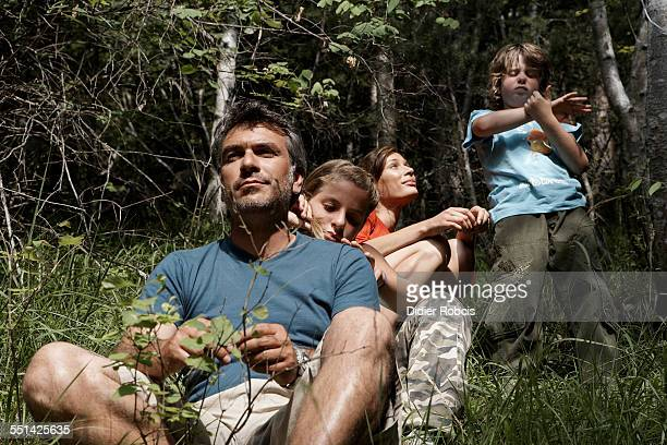 Family Exploring a Forest