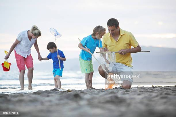 family exploring on beach